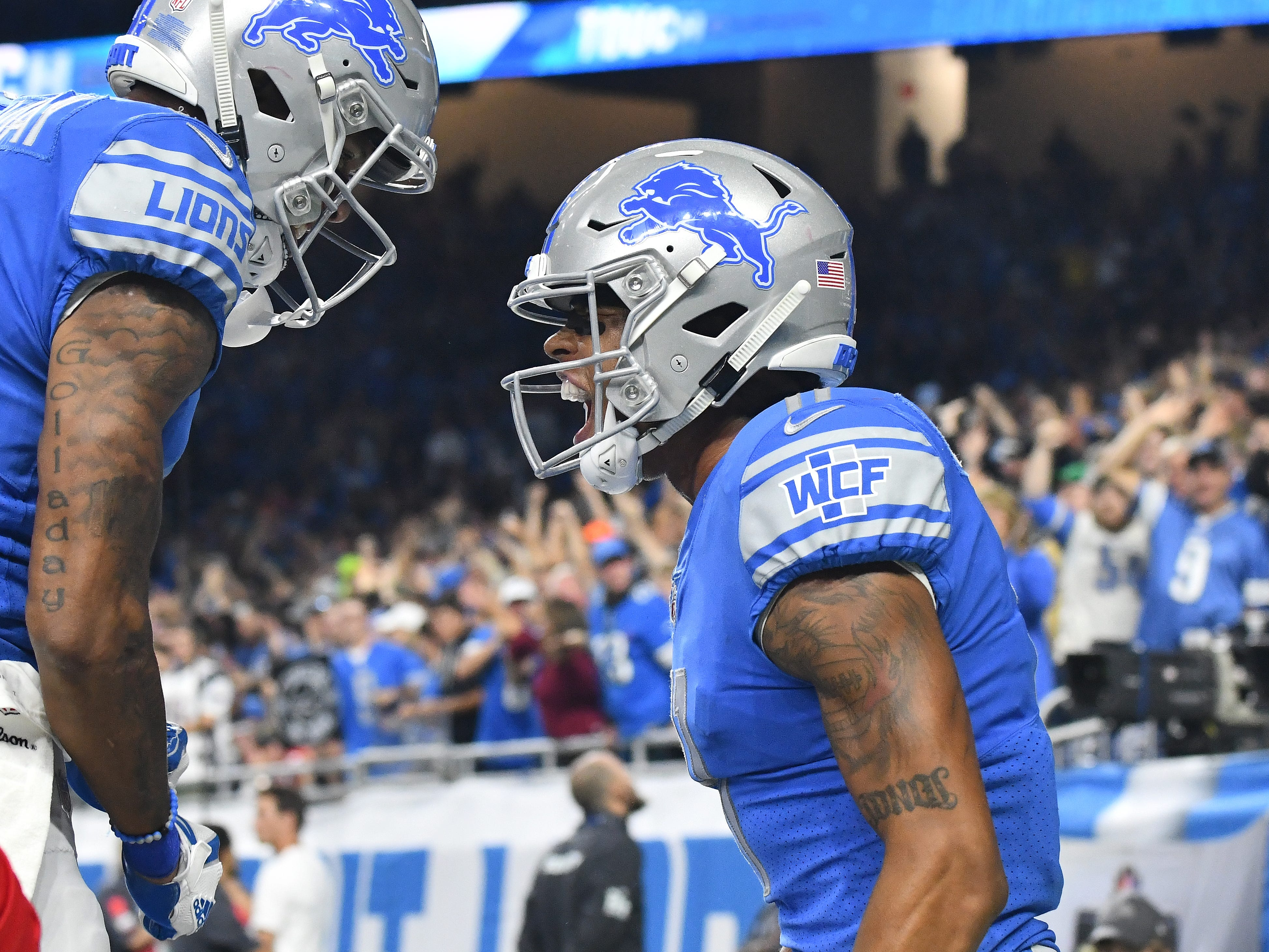 Lions Kenny Golladay celebrates with Marvin Jones Jr. after Jones touchdown reception in the 3rd quarter.