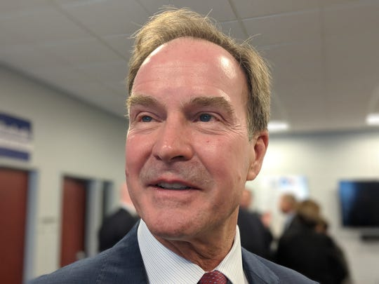 Attorney General Bill Schuette talks with reporters at the Kent County GOP headquarters in Grand Rapids on Sept. 24, 2018.