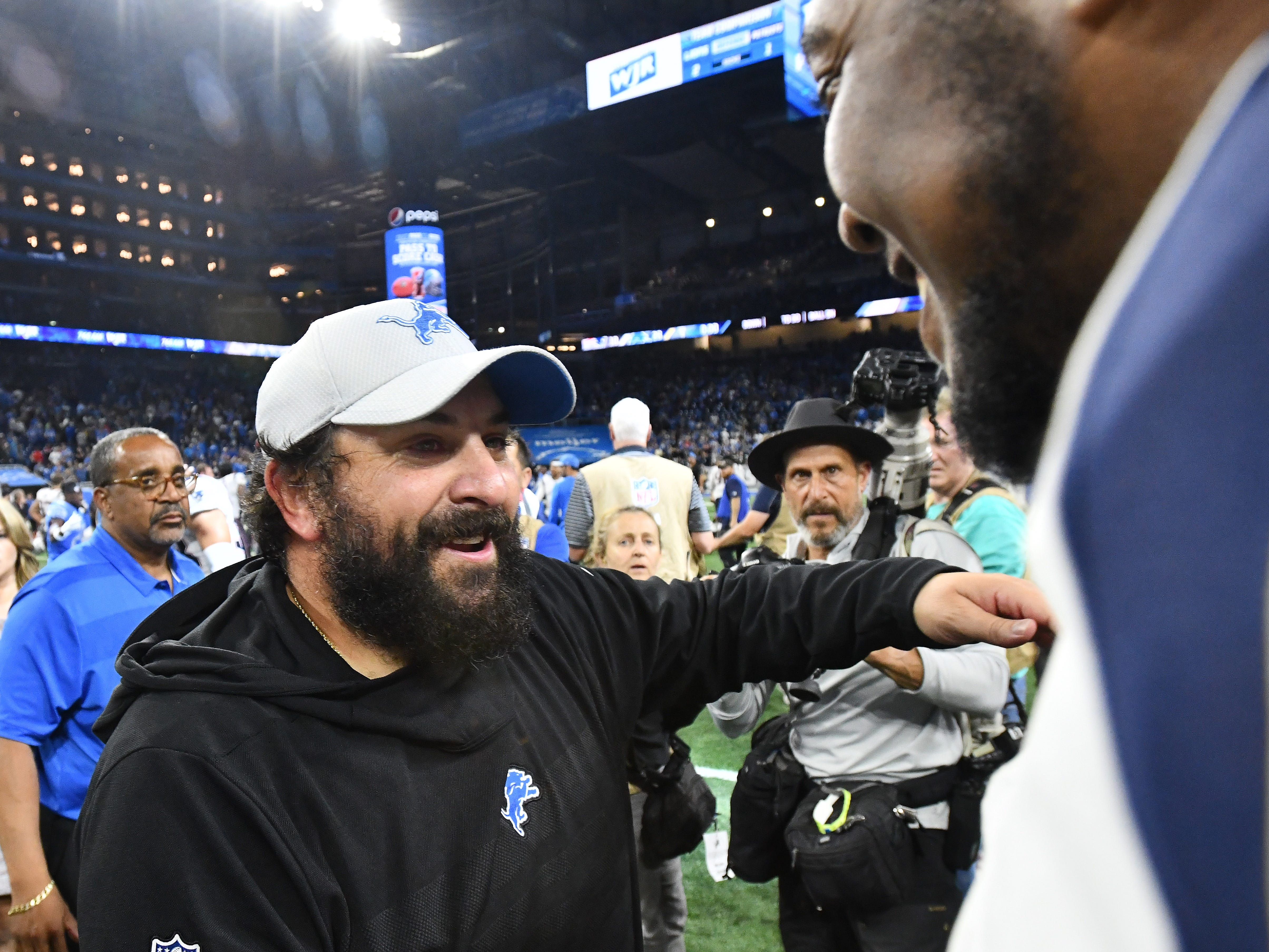 Lions head coach Matt Patricia hugs one of his former players, Patriots' Adam Butler on the field after the Detroit victory.