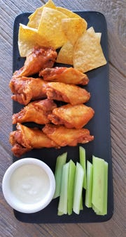 Find your game day favorites at MaryScott's, including hot wings with chips, veggies and dip