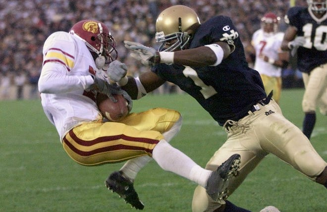 Southern California's R. Jay Soward left makes a touchdown catch in front of Notre Dame's Deke Cooper in the second quarter Saturday Oct. 16 1999 in South Bend Ind. (AP Photo/Frank Polich)