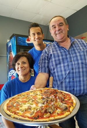 From left, Angela, Francesco, and Vitto Bommarito doing what they do best--serving pizza at DiMaggio's Pizza in Mount Vernon.