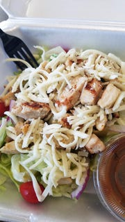 At the pizza place while on a low-carb diet? We feel ya. DiMaggio's offers a delicious crunchy salad with grilled chicken and cheese that will rescue you.