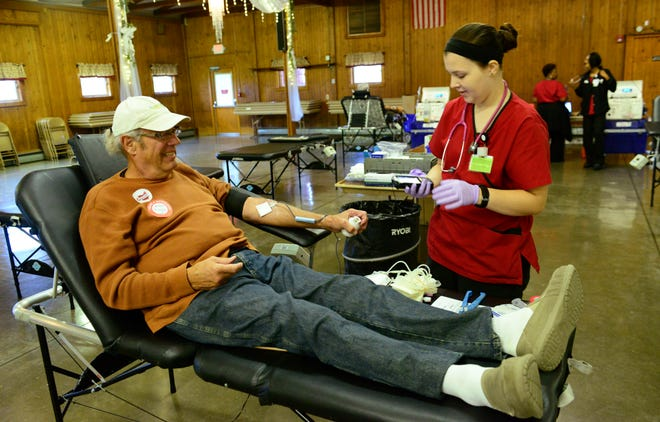 Roger Wise donates blood through the Red Cross while monitored by Kristal Pushman at Ole Zim's Wagon Shed on Monday afternoon.
