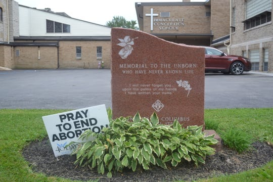 This memorial to the unborn stands outside Immaculate Conception Church and School to honor babies lost through abortion.