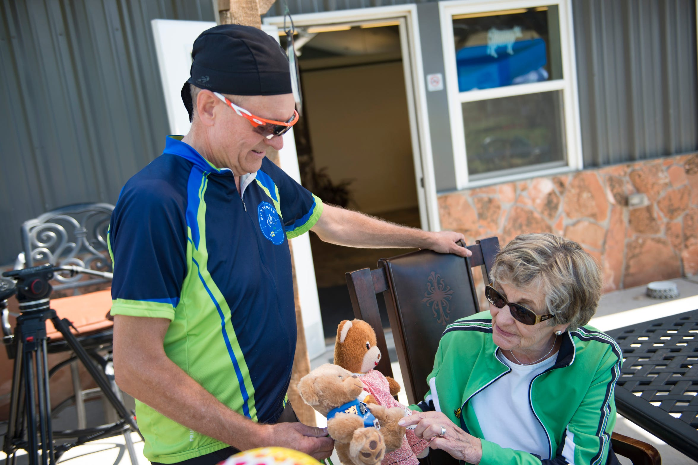 Bob Falkenberg shows Sherry Graves the bear he carries with him on his bicycle inspired by her daughter, Laura, during a Be The Match event hosted by Morning Fresh Dairy on Saturday, September 8, 2018. Laura Graves was 10 years old when she became the first bone marrow transplant recipient to fight her Leukemia.