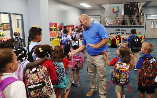 Caloosa Elementary School principal Ashley LaMar greets students on Monday 9/24/2018 at the Cape Coral school. He was a former turn around principal at Manatee Elementary.