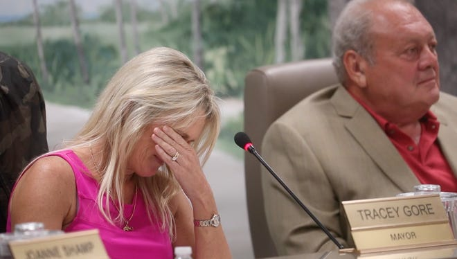 From this video screen shot. Fort Myers Beach Mayor Tracey Gore reacts while listening to her supporters during a town council meeting on Monday 9/24/2018. Gore and fellow council member Dennis Boback, pictured on the right,  were photographed and allegedly recorded talking about the TPI resort lawsuit with the plaintiff, Chris Patton at the Beached Whale. The Estero Island Taxpayers Association says they have filed a complaint with state attorney's office alledging a sunshine law violation.