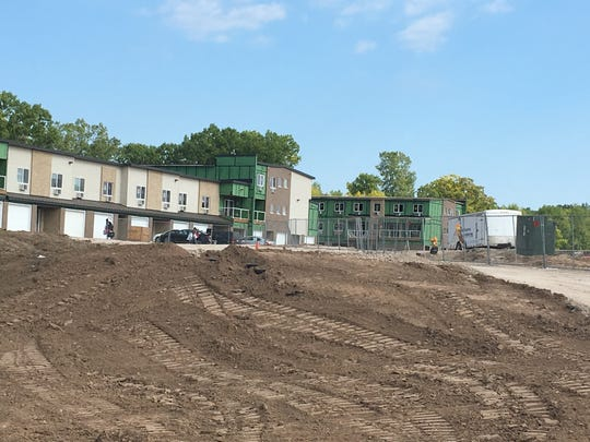 Demolition and construction continue on the former JBS Packerland Packing site off University Avenue. The first phase of new apartments is student housing.