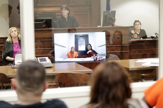Assistant State Public Defender Alli Pedersen, on the video screen with a client at the jail, takes part in a bond hearing Sept. 17 at the Brown County Courthouse in Green Bay.