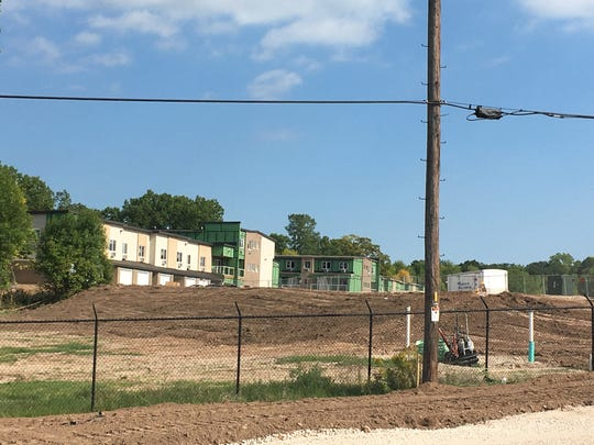 One building has already been completed in the University Heights at Baird Creek development. Work started in March after the city approved a redevelopment plan for the former JBS Packerland Packing site.
