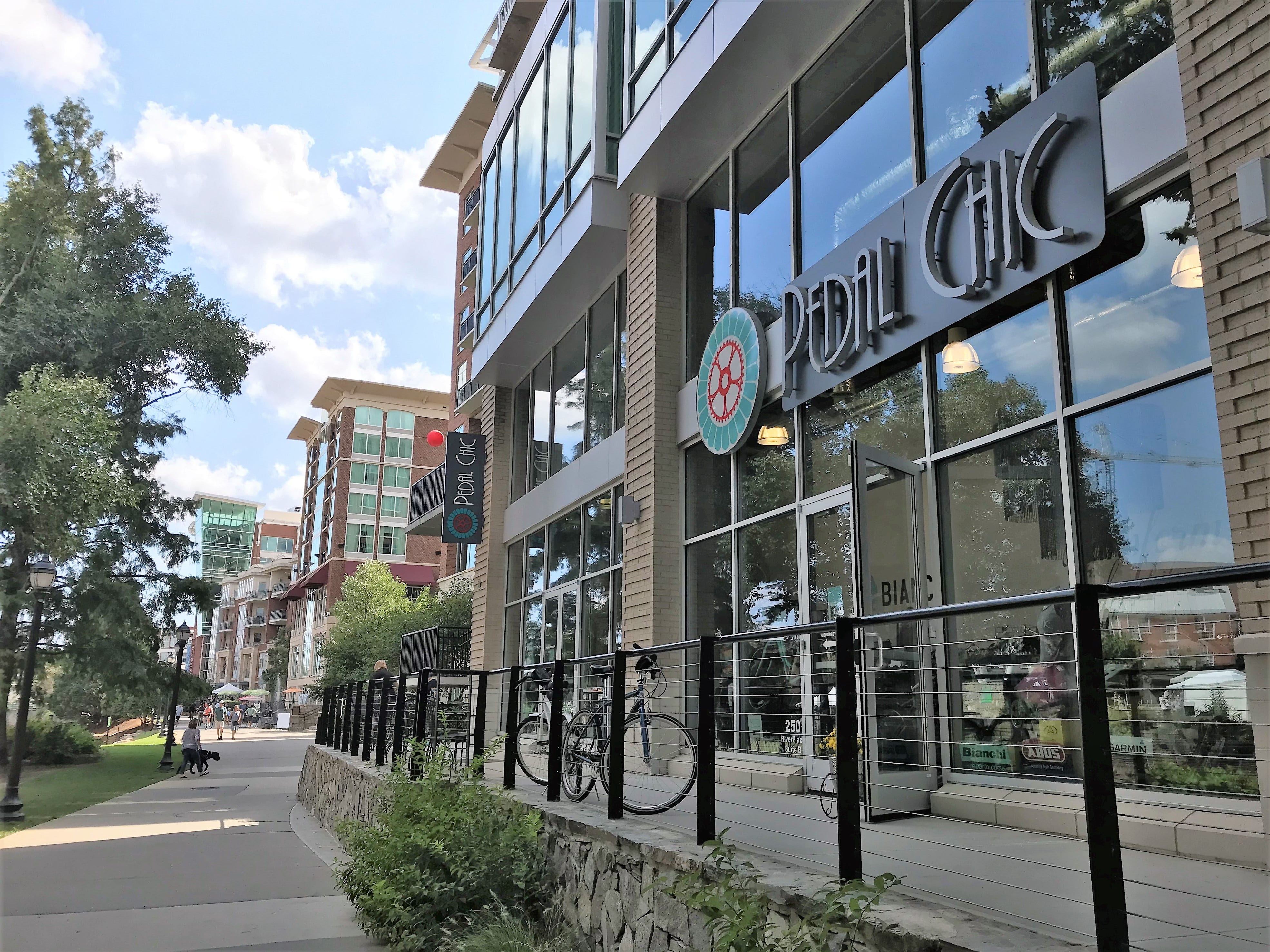 """The National Bicycle Dealers Association names two Greenville stores among """"America's Best Bike Shops"""" in 2018 -- FreeHub Bicycles and Pedal Chic, whose shop fronts the Reedy River."""