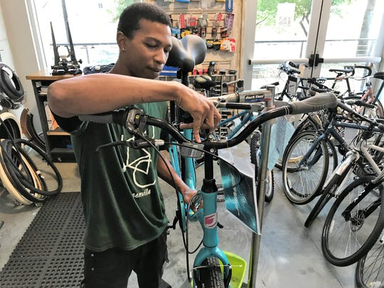 Sean Allen works on a set of handlebars at the Pedal Chic bike shop in Greenville on Friday, Sept. 21, 2018. The shop's owner, Robin Bylenga, said consumers should brace for price increases as the bike industry absorbs a 15-percent tariff increase on bike parts imported from China.