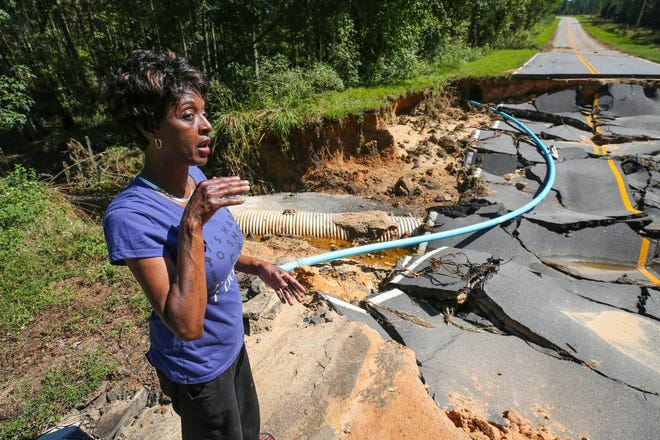 Crystal Simmons, of Wallace, S.C., says a friend totaled his car after crashing into this storm-damaged road after Hurricane Florence hit.