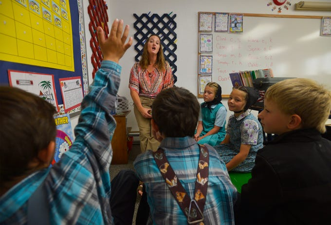 8:41 am:  Traci Manseau leads her younger students in a lesson on days of the week, Monday, Sept. 17, 2018.  Manseau is a teaching veteran of 23 years and she has spent her entire career teaching in one room rural school houses.  She is currently teaching 15 students across seven different grade levels at the Deerfield Hutterite Colony in North Central Montana's Fergus County.