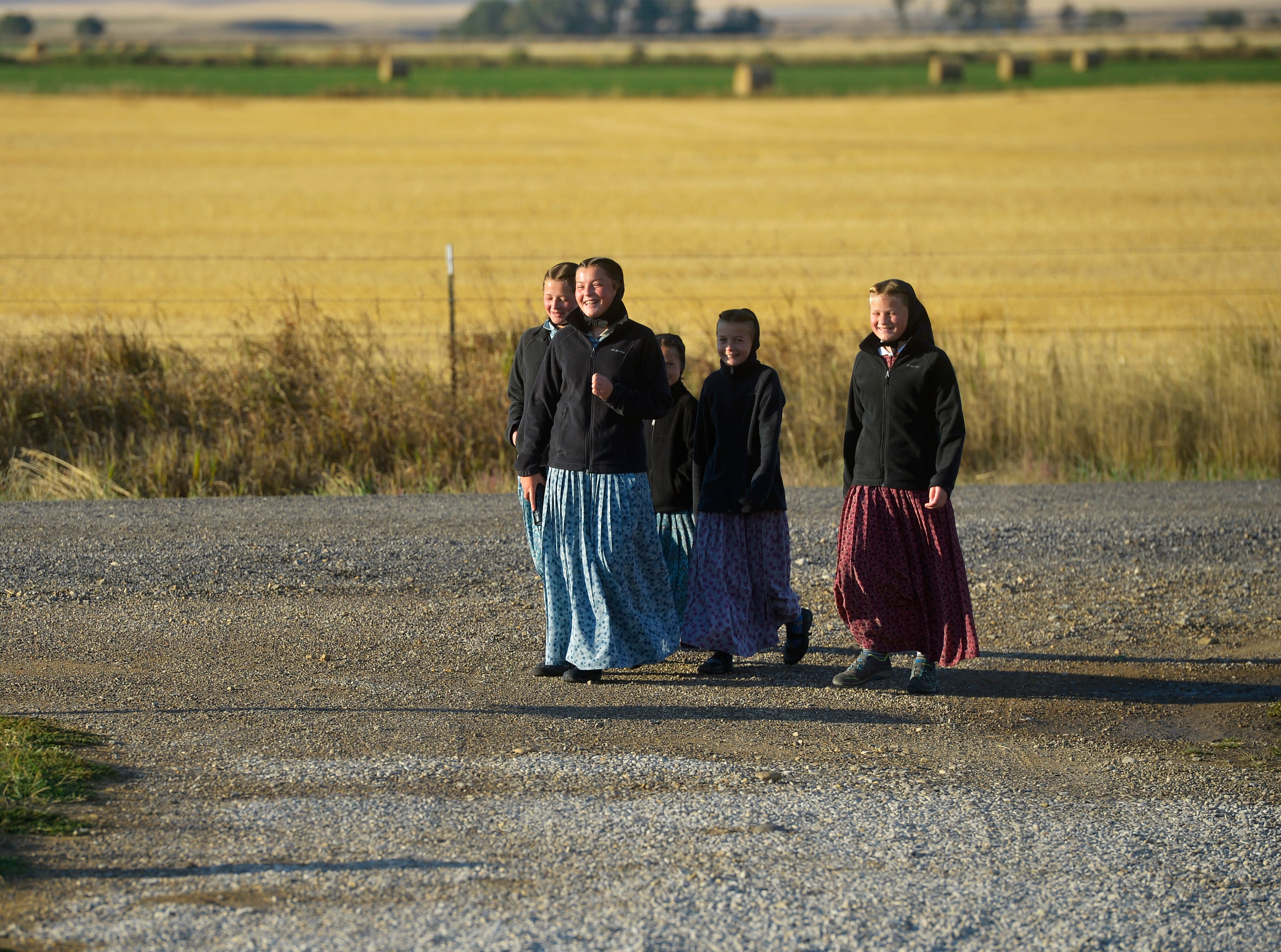 8:20 am: Traci Manseau's students arrive at school, a short walk down the gravel road from their home on the Deerfield Hutterite Colony, Monday, Sept. 17, 2018.  Manseau is a teaching veteran of 23 years and she has spent her entire career teaching in one room rural school houses.  She is currently teaching 15 students across seven different grade levels at the Deerfield Hutterite Colony in North Central Montana's Fergus County.