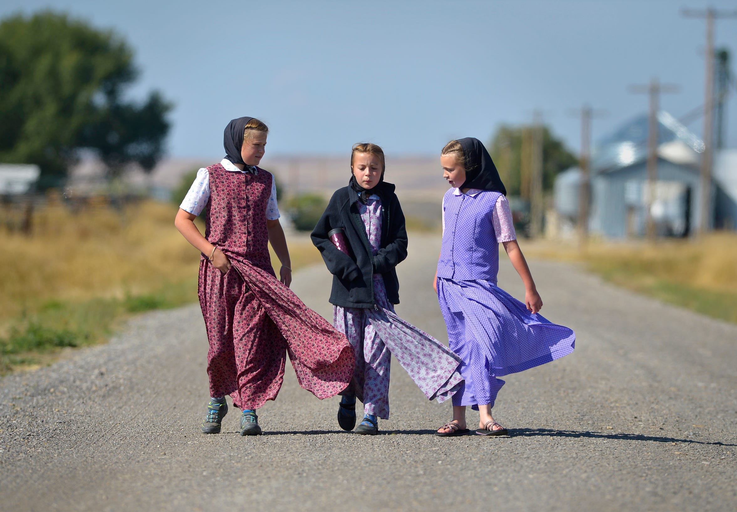 Alana Stahl, left, Taya Stahl and Danielle Stahl return from lunch on the Deerfield Hutterite Colony.
