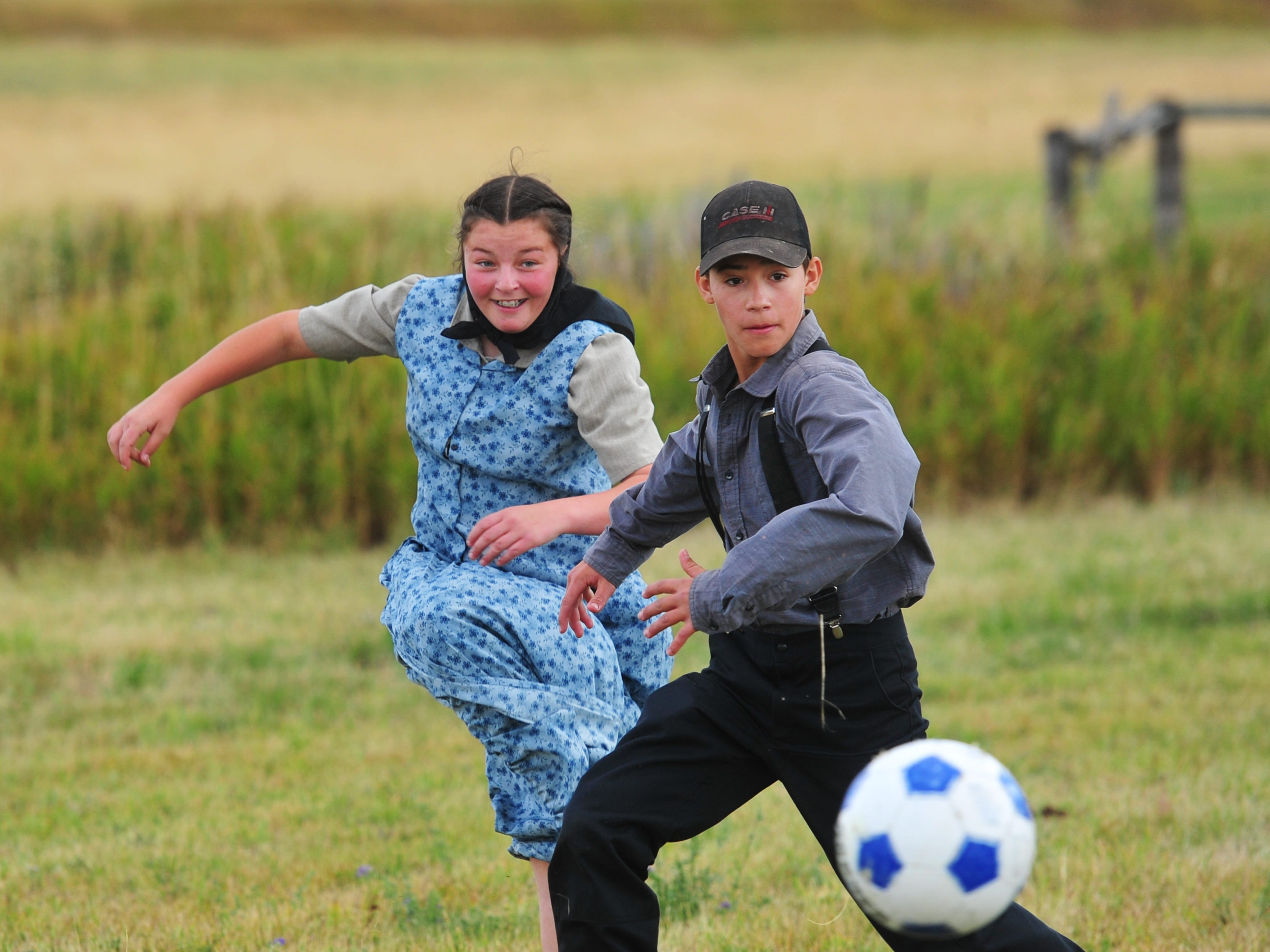 1:27 pm:  Eighth graders Geena and Austin Stahl play soccer during their afternoon recess on Monday, Sept. 17, 2018.  Soccer is one of the more popular sports with the kids in Traci Manseau's class at the Deerfield Hutterite Colony, with teams often being girls versus boys.  Traci Manseau is a teaching veteran of 23 years and she has spent her entire career teaching in one room rural school houses.  She is currently teaching 15 students across seven different grade levels at the Deerfield Hutterite Colony in North Central Montana's Fergus County.