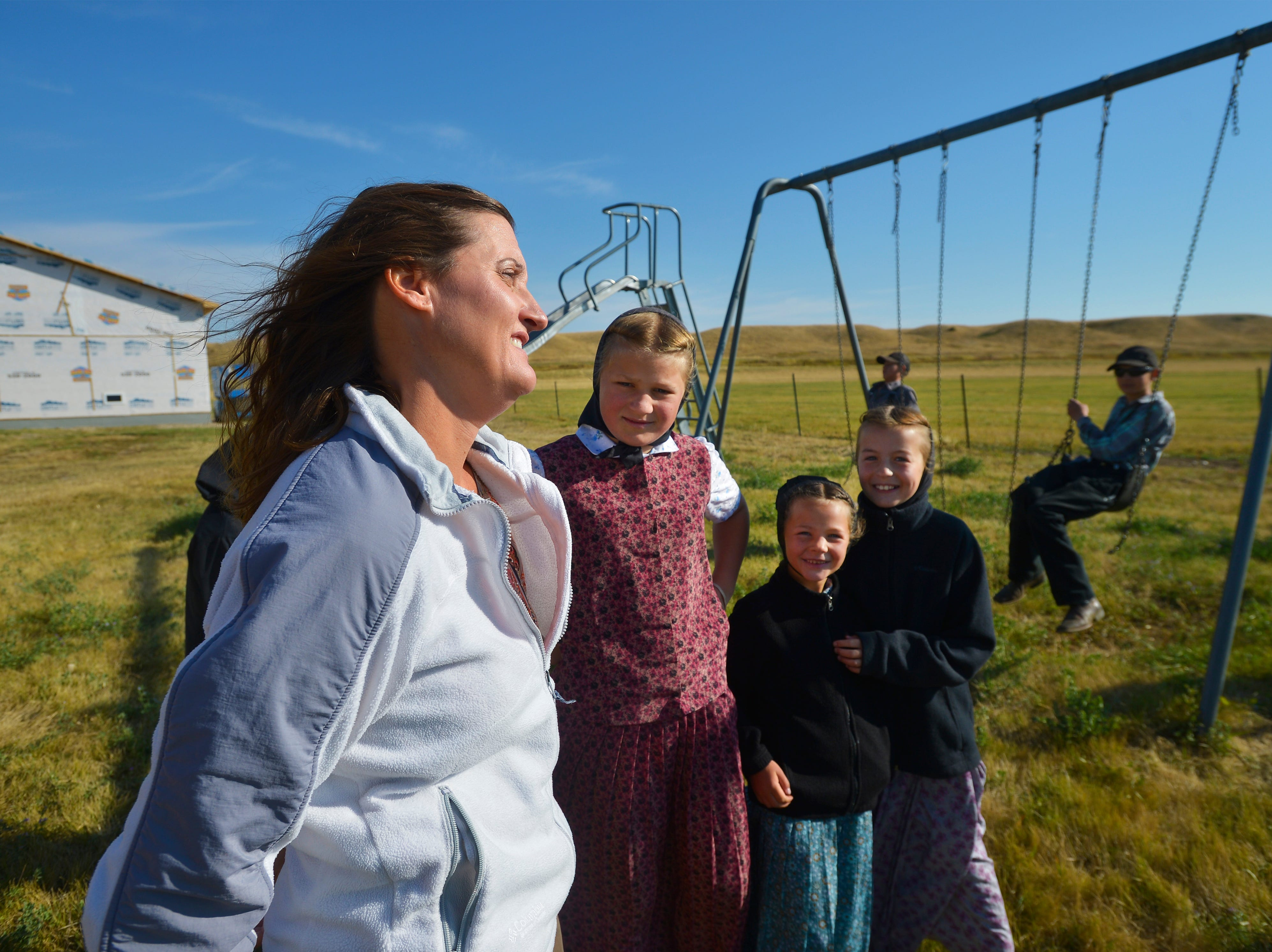 9:58 am: Traci Manseau watches her kids during recess, Monday, Sept. 17, 2018.  Manseau is a teaching veteran of 23 years and she has spent her entire career teaching in one room rural school houses.  She is currently teaching 15 students across seven different grade levels at the Deerfield Hutterite Colony in North Central Montana's Fergus County.