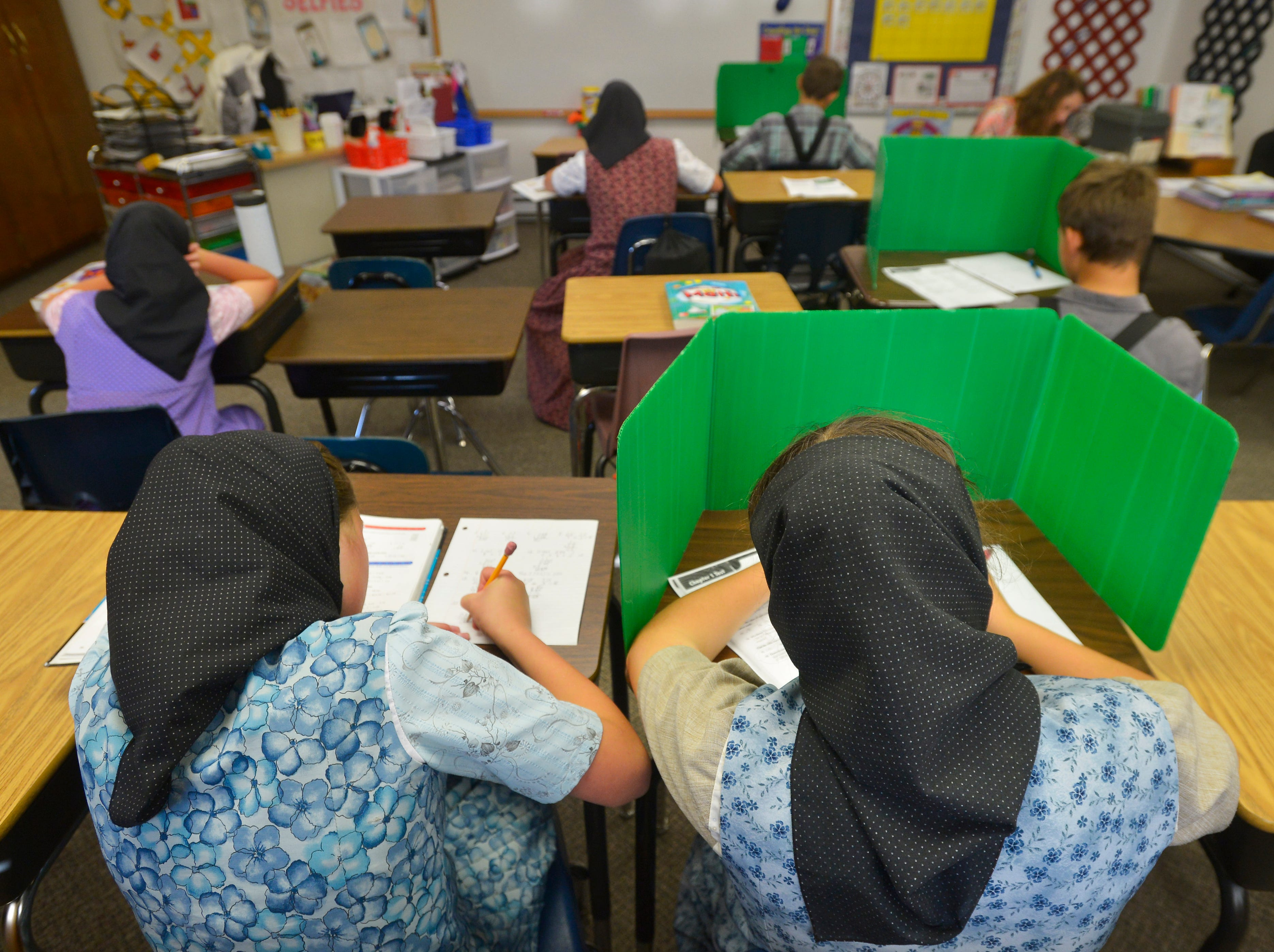 9:22 am:  Traci Manseau's students work quietly at their desks on Monday, September 17, 2018.  Manseau is a teaching veteran of 23 years and she has spent her entire career teaching in one room rural school houses.  She is currently teaching 15 students across seven different grade levels at the Deerfield Hutterite Colony in North Central Montana's Fergus County.
