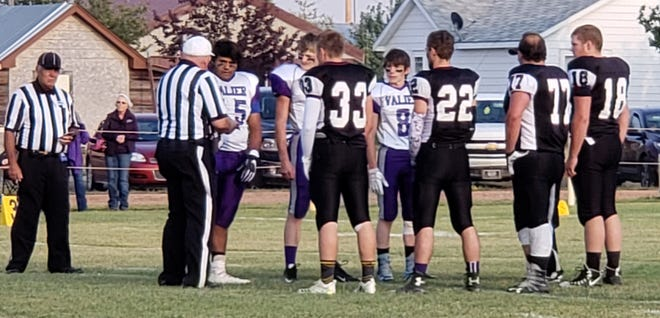 Power-Dutton-Brady captains participate in the coin toss prior to a recent game against Valier. Pictured at Peyton Hill (33), Joey Zylks (22), Zane Somerfeld (77) and Conan Rehm (18). Not pictured is Titans' captain Gaije Blackwell.