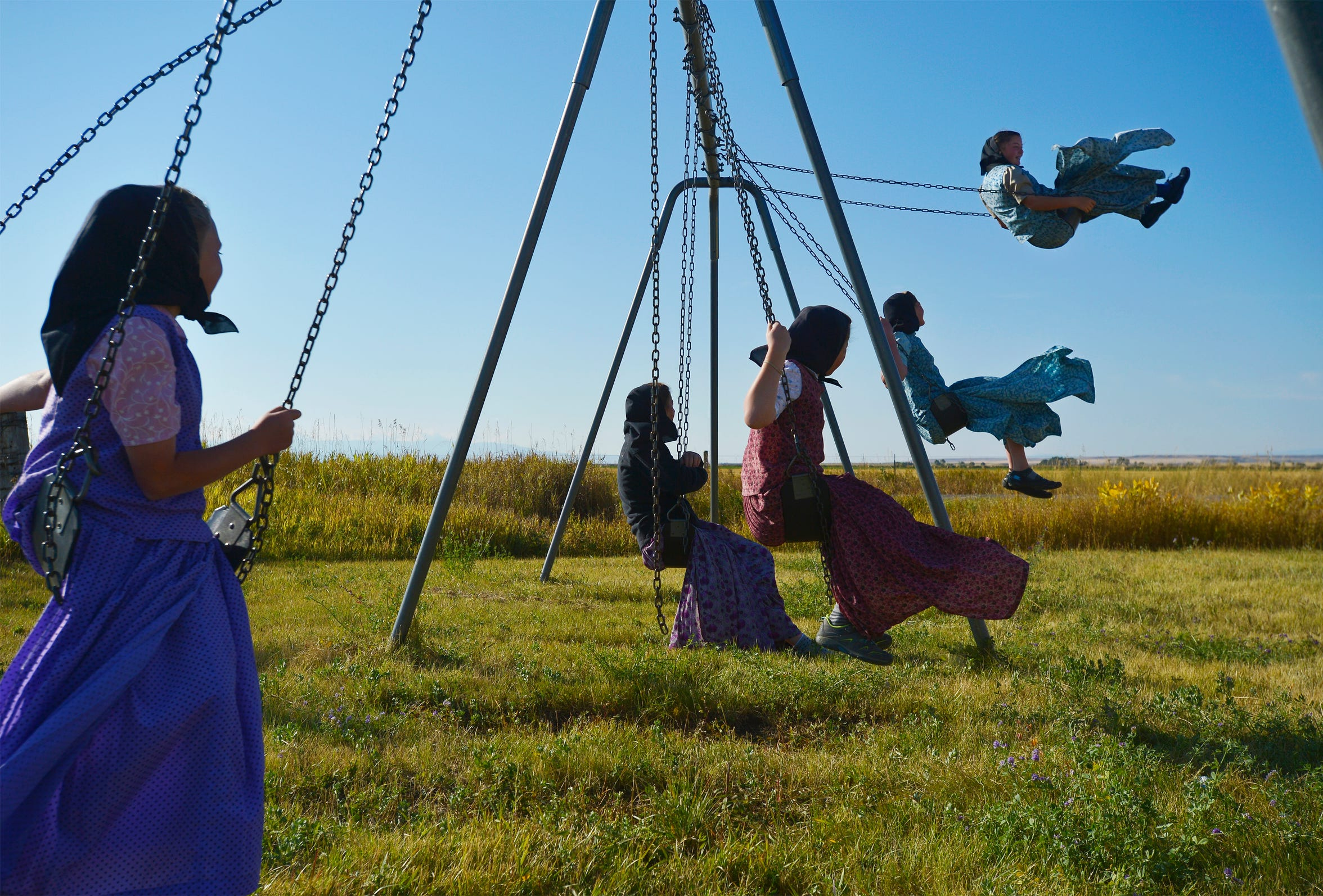 Swinging is a favorite recess activity for students in Traci Manseau's class on the Deerfield Hutterite Colony.