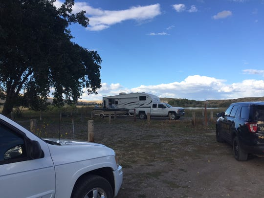 Two bodies were discovered in a camper at Pelican Point Fishing Access Site Sunday.