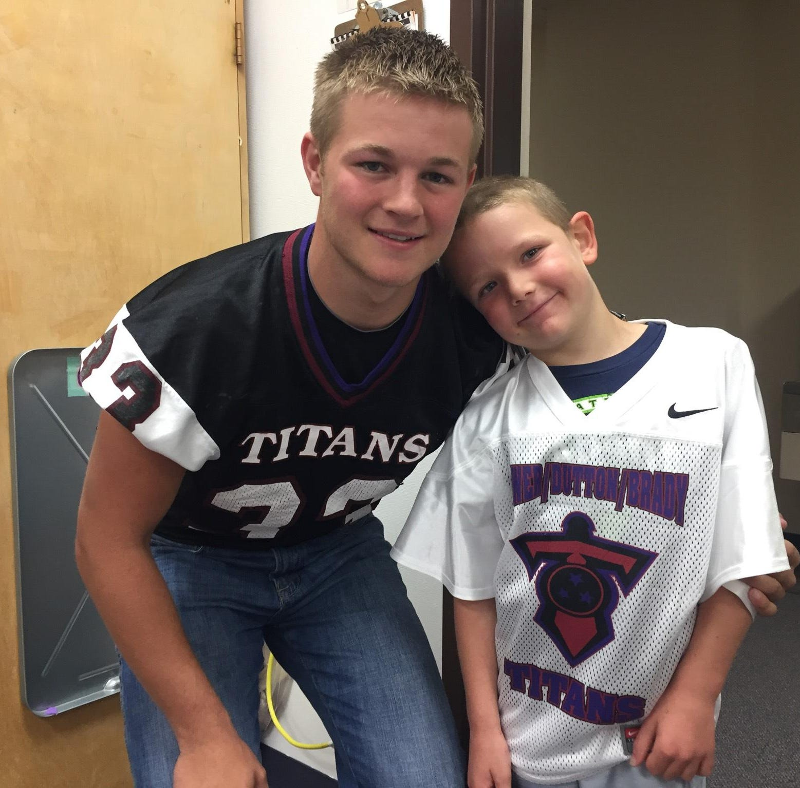 Football teams rally in support of young fans Calvin, Troy