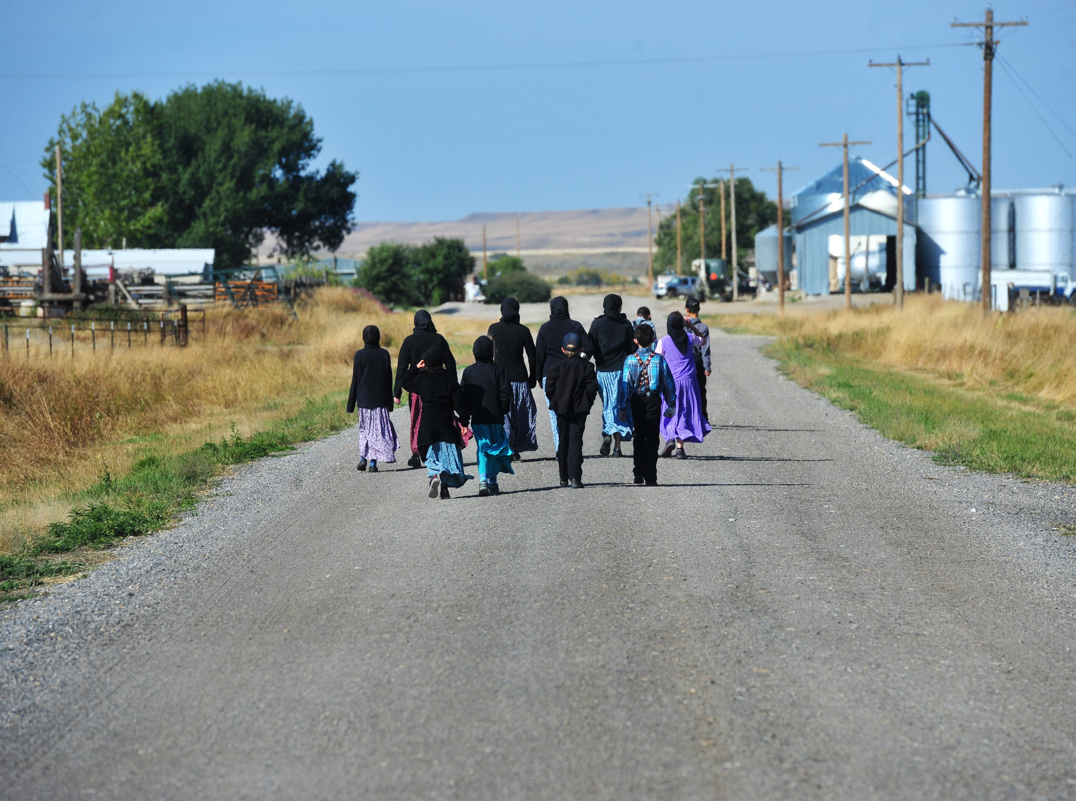 10:53 am: Traci Manseau's students walk home for lunch, Monday, Sept. 17, 2018.  Monseau is a teaching veteran of 23 years and she has spent her entire career teaching in one room rural school houses.  She is currently teaching 15 students across seven different grade levels at the Deerfield Hutterite Colony in North Central Montana's Fergus County.
