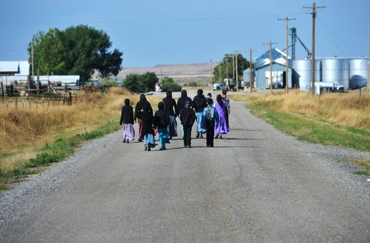 Students walk home for lunch on the Deerfield Hutterite Colony in northcentral Montana's Fergus County.