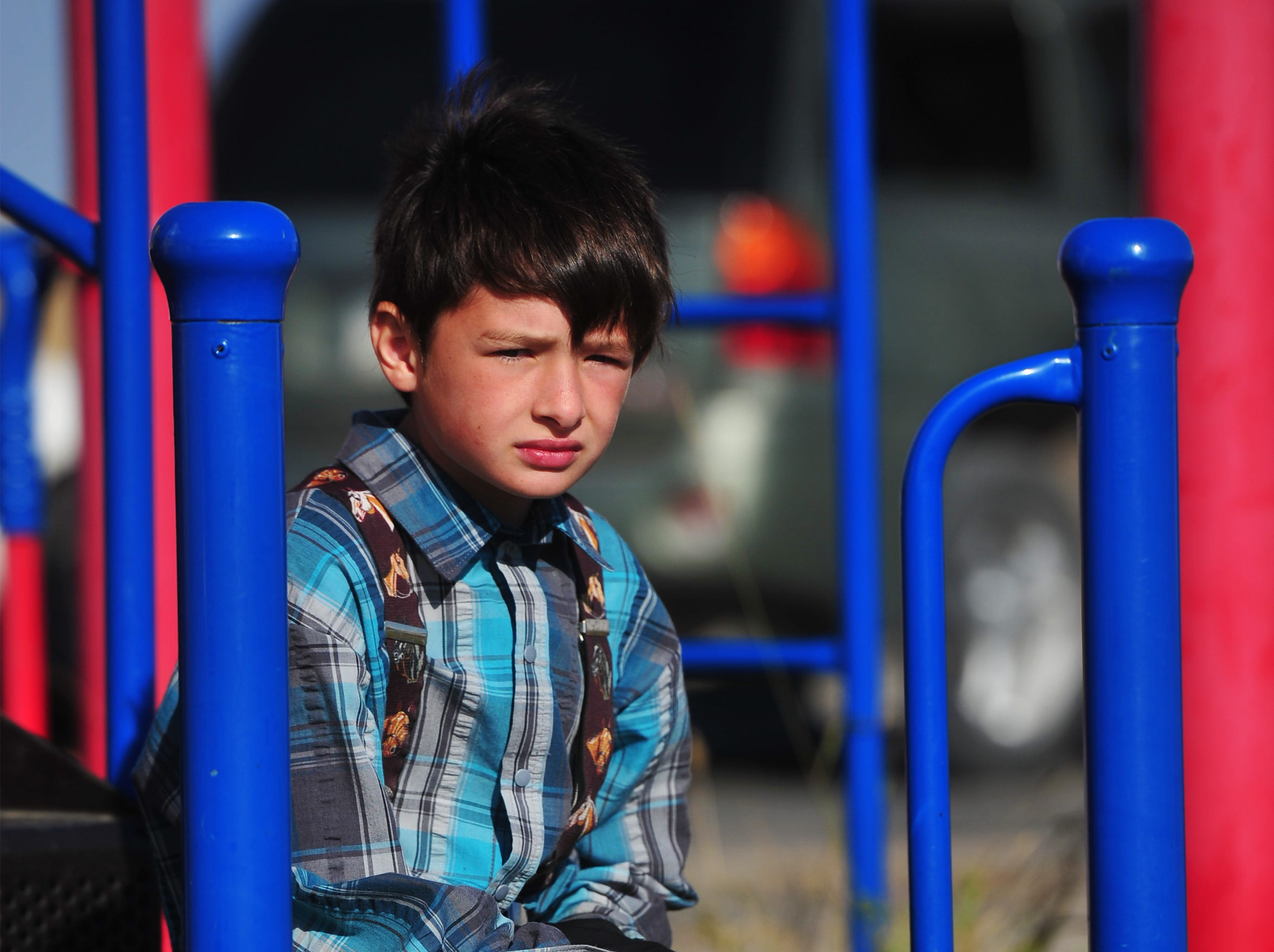 10:00 am: Timothy Stahl, a second grader in Traci Manseau's class rests on a play structure during recess, Monday, Sept. 17, 2018.  Traci Manseau is a teaching veteran of 23 years and she has spent her entire career teaching in one room rural school houses.  She is currently teaching 15 students across seven different grade levels at the Deerfield Hutterite Colony in North Central Montana's Fergus County.