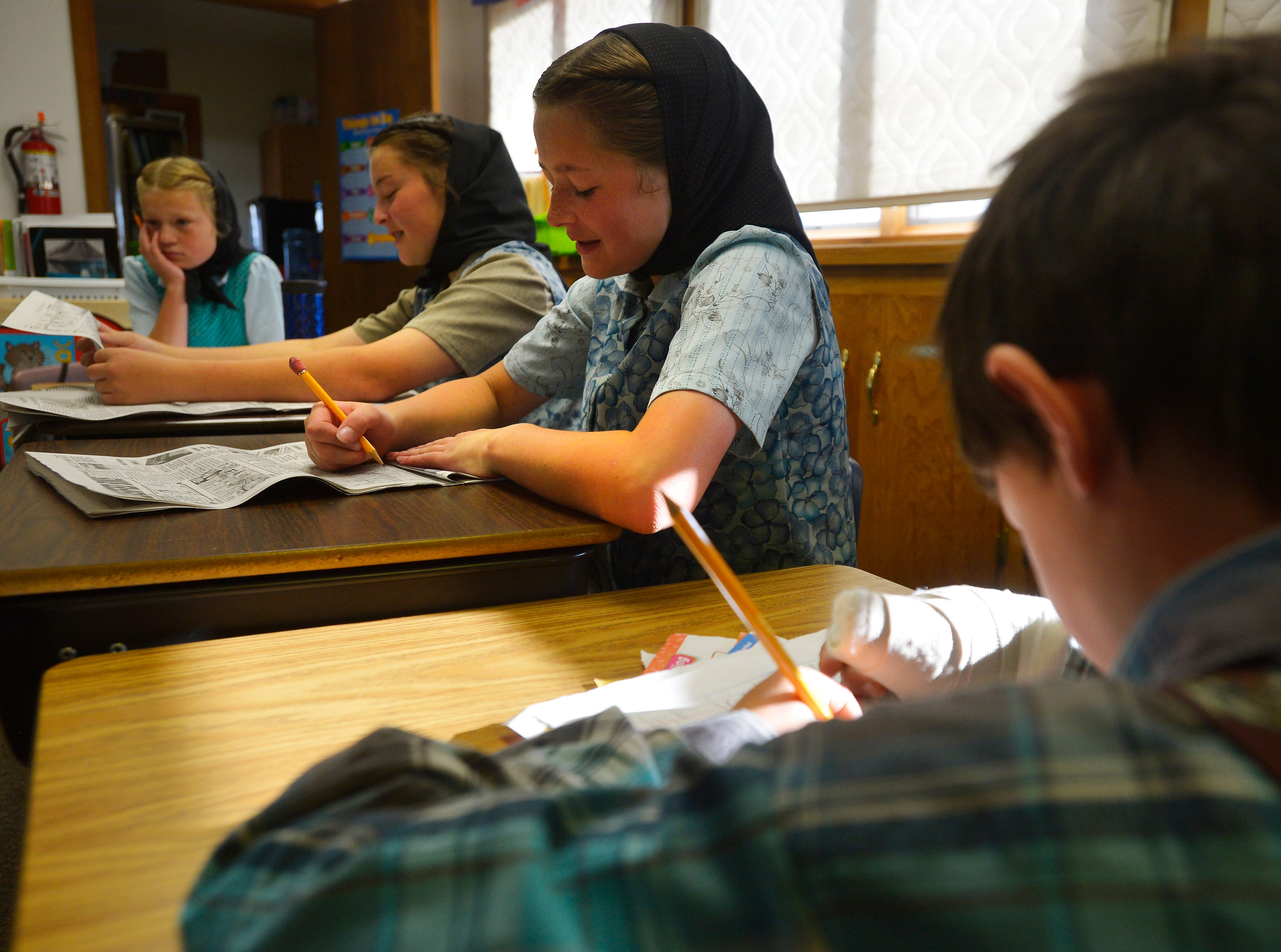 8:35 am:  Traci Manseau's students work at their desks, Monday, Sept. 17, 2018.  Manseau is a teaching veteran of 23 years and she has spent her entire career teaching in one room rural school houses.  She is currently teaching 15 students across seven different grade levels at the Deerfield Hutterite Colony in North Central Montana's Fergus County.