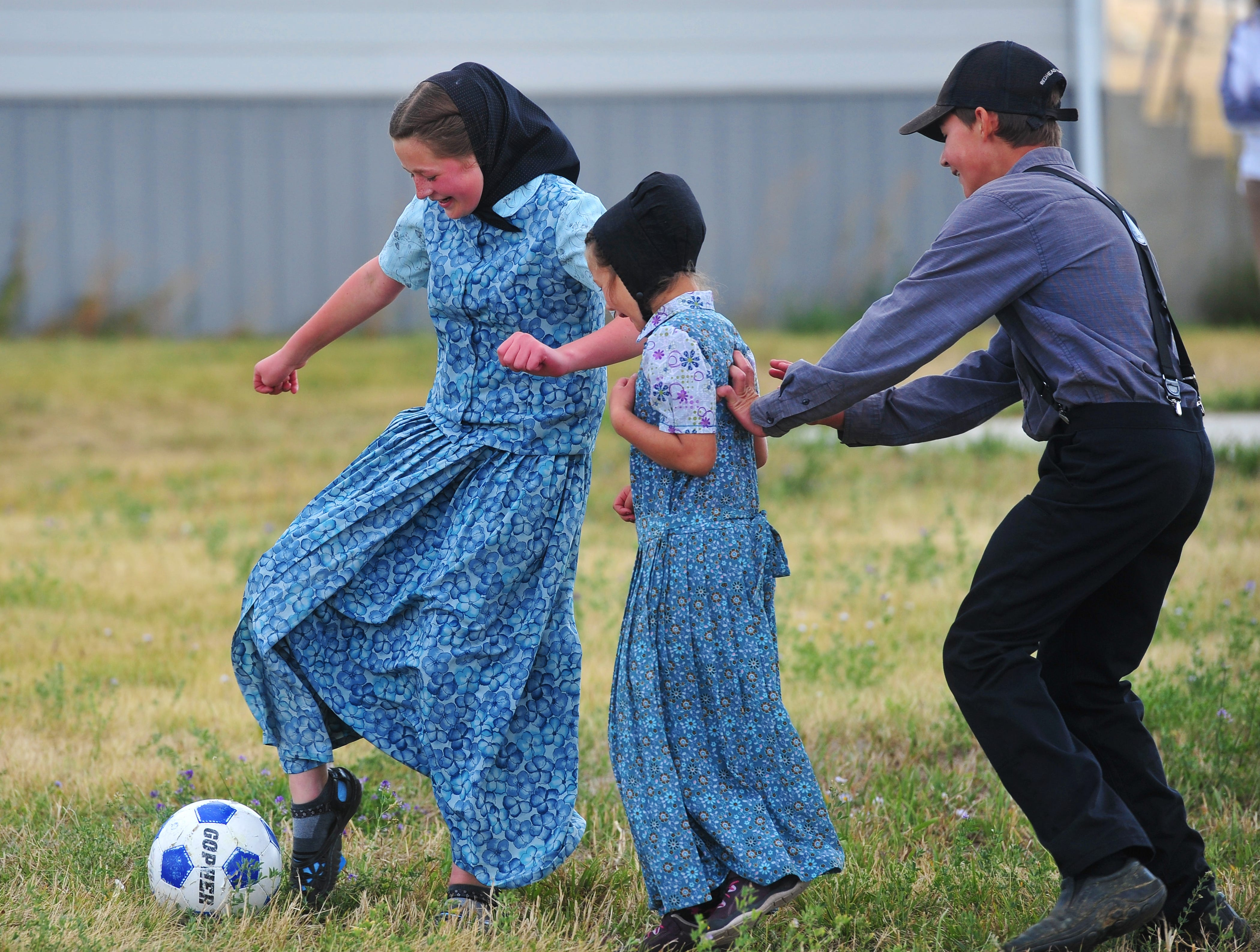 Geena Stahl, left, Amber Stahl, center, and Austin Stahl play soccer at recess on Monday, Sept. 17, 2018.  Traci Manseau is a teaching veteran of 23 years and she has spent her entire career teaching in one room rural school houses.  She is currently teaching 15 students across seven different grade levels at the Deerfield Hutterite Colony in North Central Montana's Fergus County.