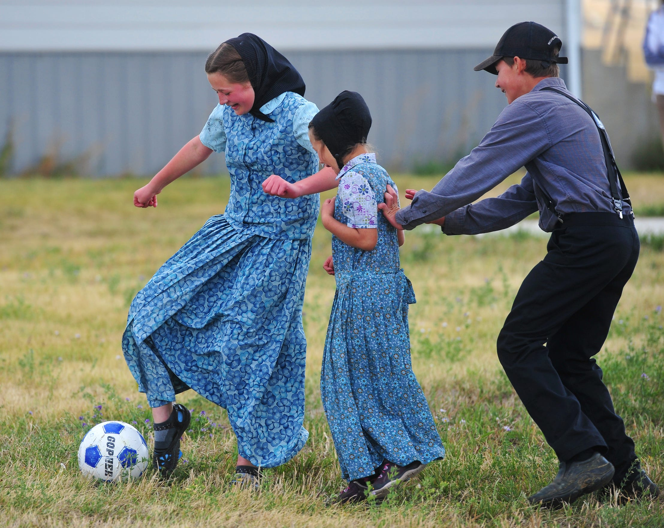 Geena Stahl, left, Amber Stahl, center, and Austin Stahl play soccer at recess at Deerfield School.