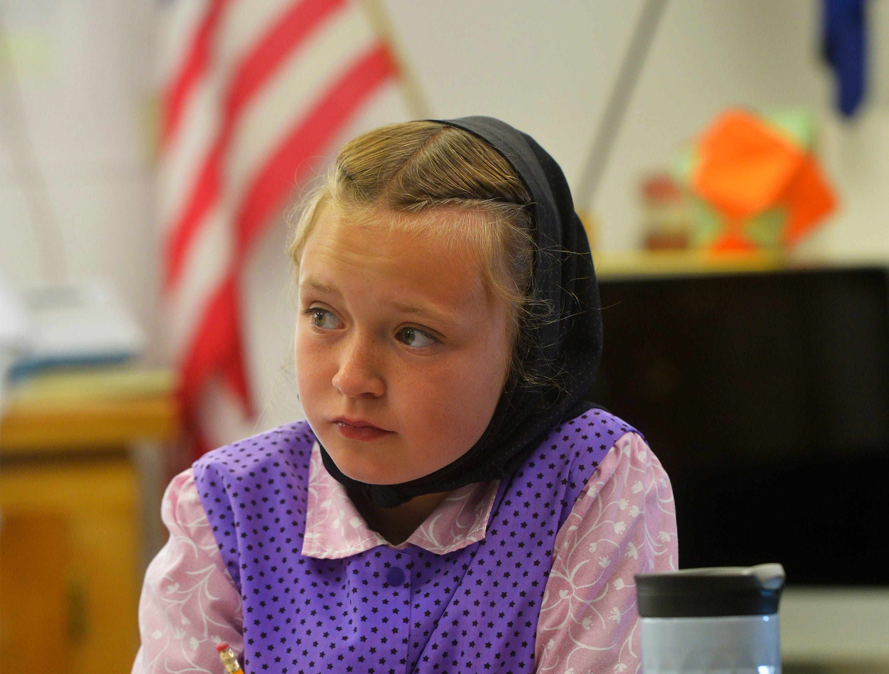 Fifth grader Danielle Stahl works at her desk in Traci Manseau's classroom on the Deerfield Hutterite Colony, Monday, Sept. 17, 2018. Manseau is a teaching veteran of 23 years and she has spent her entire career teaching in one room rural school houses.  She is currently teaching 15 students across seven different grade levels at the Deerfield Hutterite Colony in North Central Montana's Fergus County.