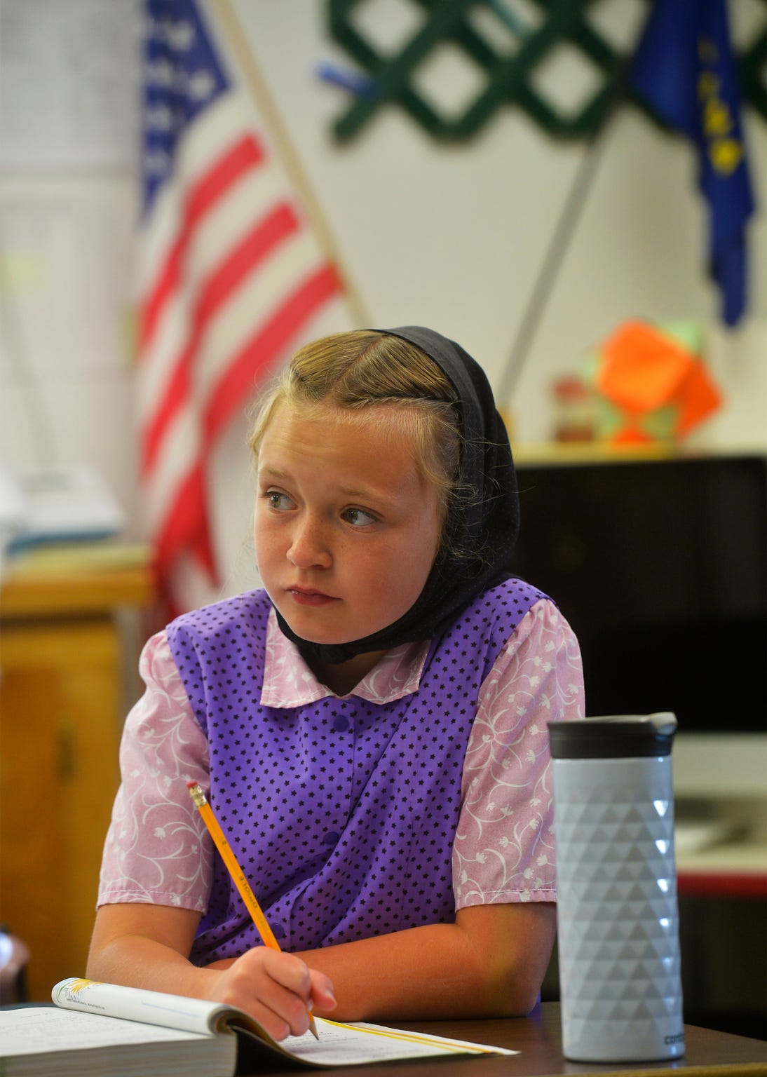 Fifth-grader Danielle Stahl works at her desk in Traci Manseau's classroom at the Deerfield Hutterite Colony.