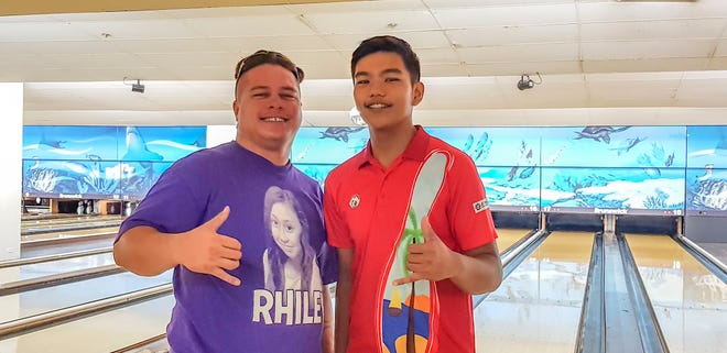 From left: Jesse Flickinger and Jeremiah Camacho win Prince and King of the Lanes on Sept. 23, 2018.