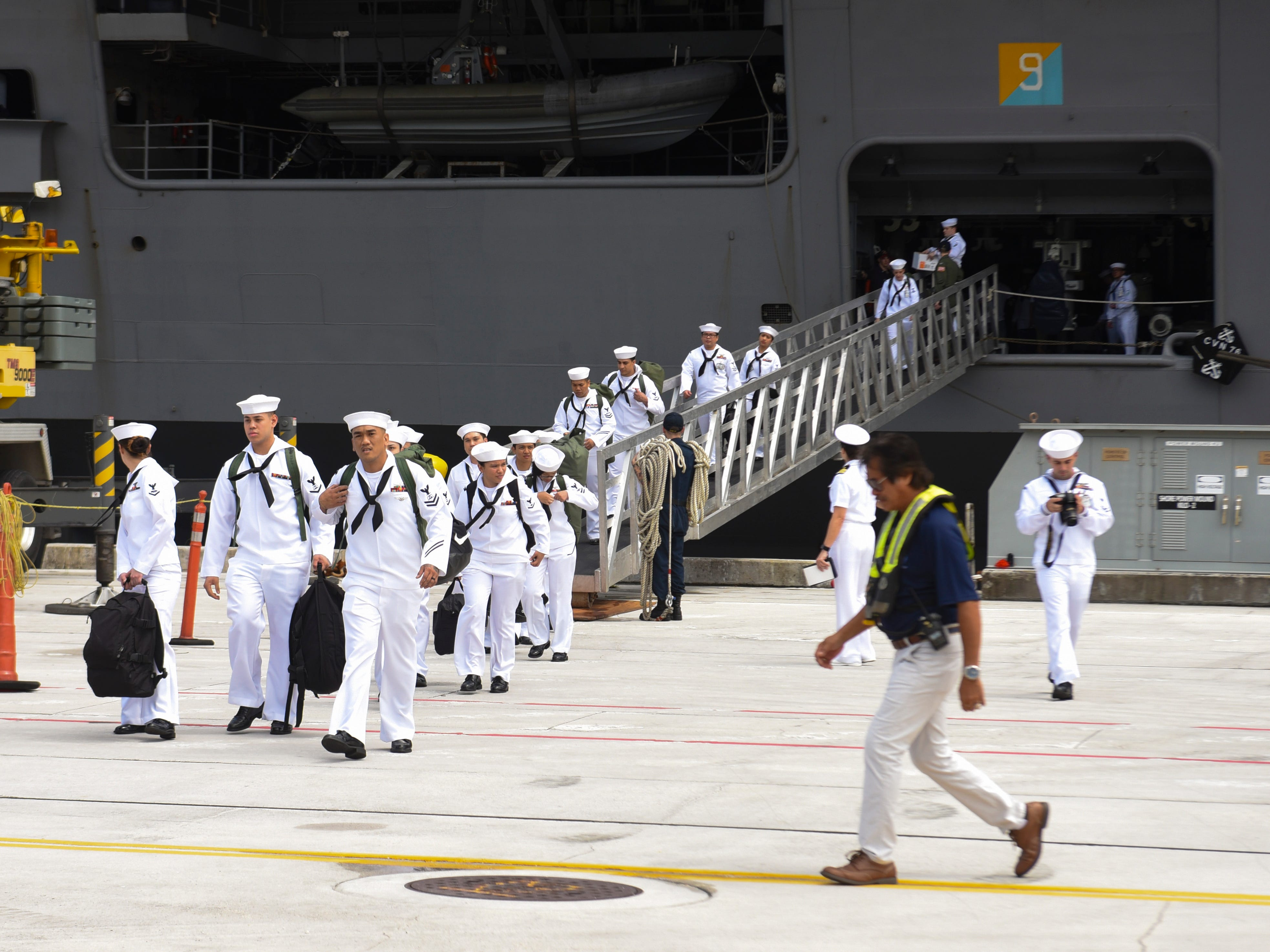 Sailors with Guam ties disembark from the Nimitz-class nuclear-powered aircraft carrier, USS Ronald Reagan, after the ship docked at the Kilo Wharf on Naval Base Guam in Sumay on Monday, Sept. 24, 2018. The vessel and its crew of nearly 5,000 sailors, normally forward-deployed at Yokosuka, Japan, is paying a port visit to the island.