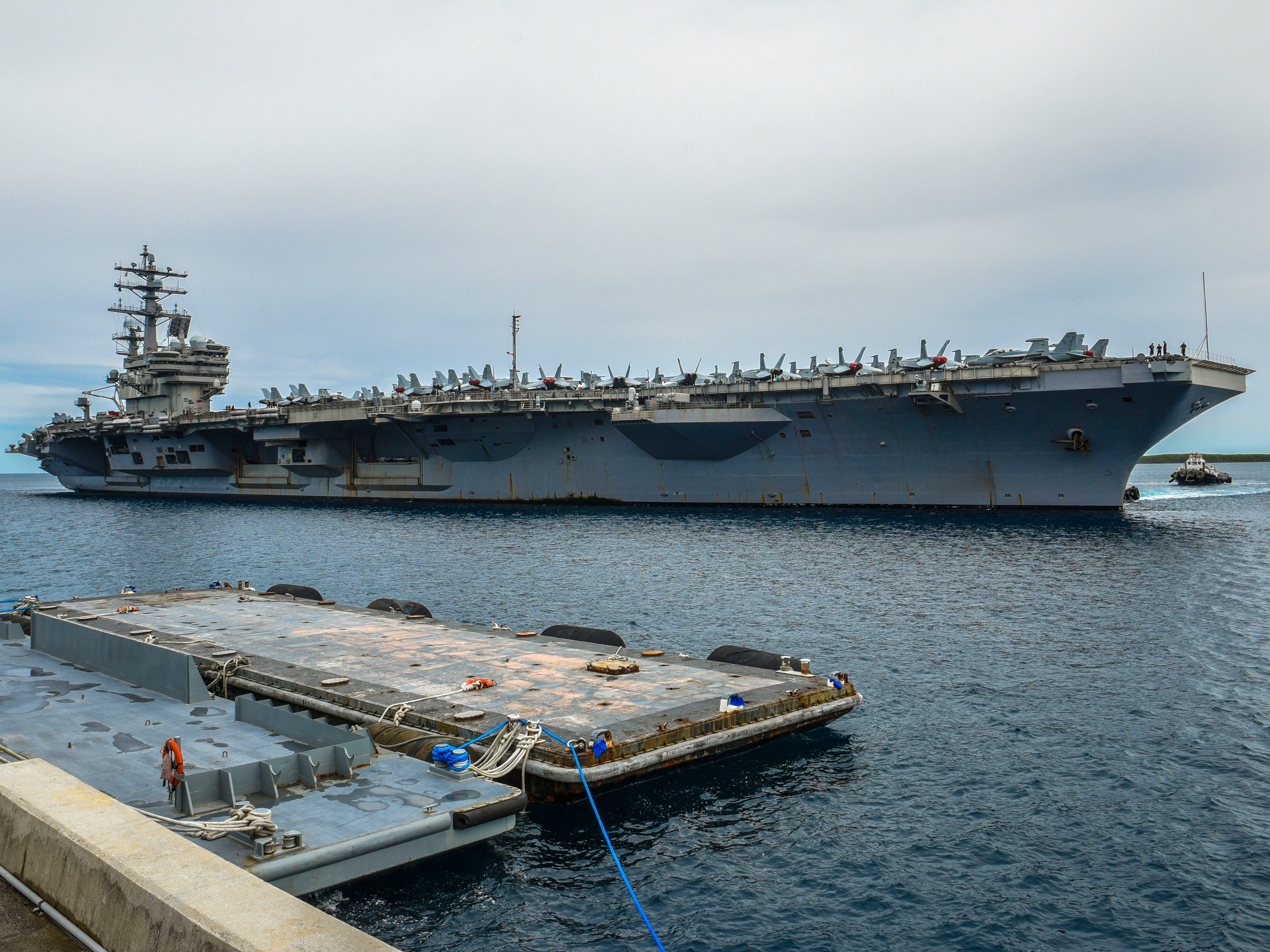The Nimitz-class nuclear-powered aircraft carrier, USS Ronald Reagan, prepares to dock at the Kilo Wharf on Naval Base Guam in Sumay on Monday, Sept. 24, 2018. The vessel and its crew of nearly 5,000 sailors, about 20 of whom have Guam ties, is normally forward-deployed at Yokosuka, Japan but is paying the island a port visit.