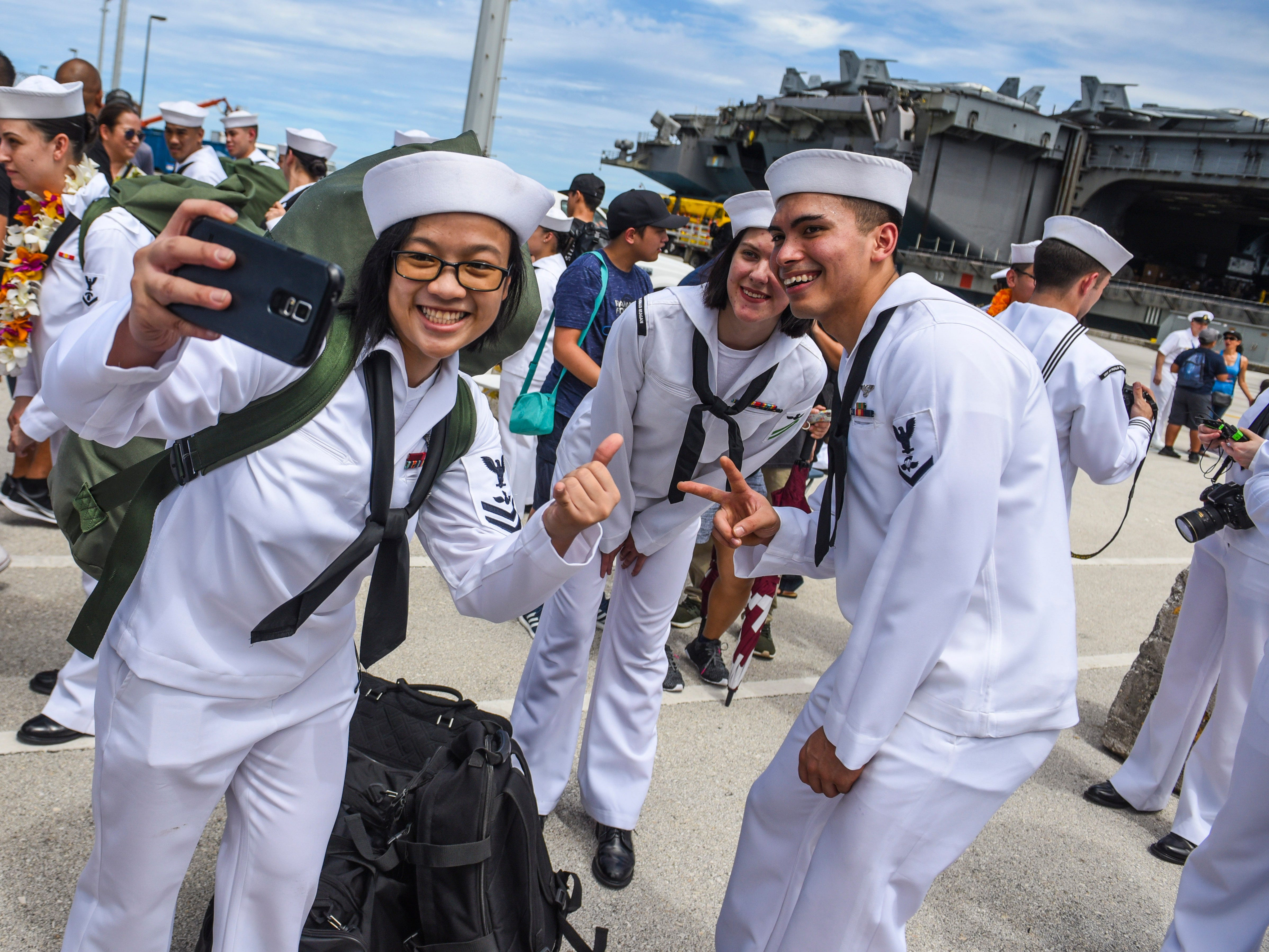 Navy sailors with Guam ties, serving aboard the Nimitz-class nuclear-powered aircraft carrier, USS Ronald Reagan, are greeted by family and friends during their arrival at the Kilo Wharf on Naval Base Guam in Sumay on Monday, Sept. 24, 2018. The vessel and its crew of nearly 5,000 sailors, normally forward-deployed at Yokosuka, Japan, is paying a port visit to the island.