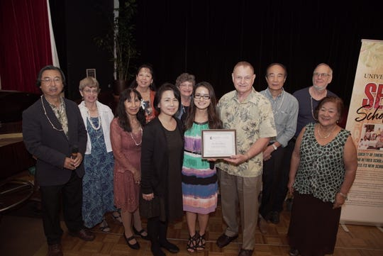Members of the University of Guam Society of Emeritus Professors and Retired Scholars present Mayumi Krause, a graduate student in the clinical psychology program at UOG, with a scholarship of $1,000. From left: Hiro Kurashina, vice chairman of the society and chairman of the society's scholarship committee; Rebecca A. Stephenson; Lourdes Klitzkie; Cynthia B. Sajnovsky; Junko Krause, mother of Mayumi; Karen A. Carpenter; Mayumi Krause; Lawrence Kasperbauer, chairman of the society; Chin-Tian Lee; Christopher S. Lobban; and Filomena Cantoria.