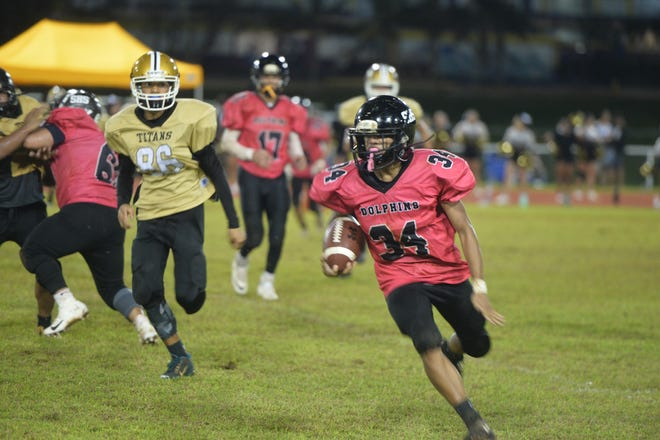 Southern Dolphins running back Cerilo Reyes cuts upfield against the Tiyan Titans Sept. 24 at the George Washington High School field. The Dolphins won 18-0 to spoil Tiyan's Homecoming.