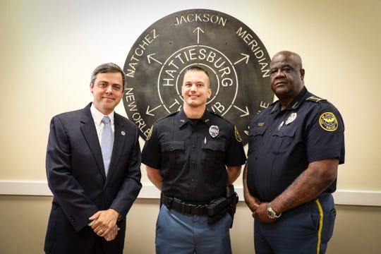 Newly sworn police officer Jared Barnard poses with Hattiesburg Mayor Toby Barker and Police Chief Anthony Parker.