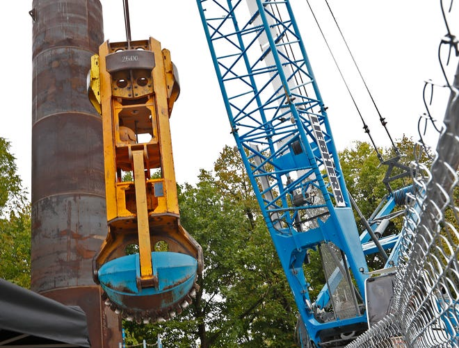 A clam bucket removes soil and rock from the drop shaft, at the Citizen's Energy DigIndy Tunnel System at the Fall Creek Tunnel Drop Shaft project site, Monday, Sept. 24, 2018. Citizens shared with the community that they are about half done with their 28-mile DigIndy project which will include 28 miles of tunnel bored 250 feet beneath the surface.  About 14 miles are done, and 10 miles are actually in operation.  Since Dec. 2017, the tunnel system has prevented 500 million gallons of raw sewage from going into rivers and streams.