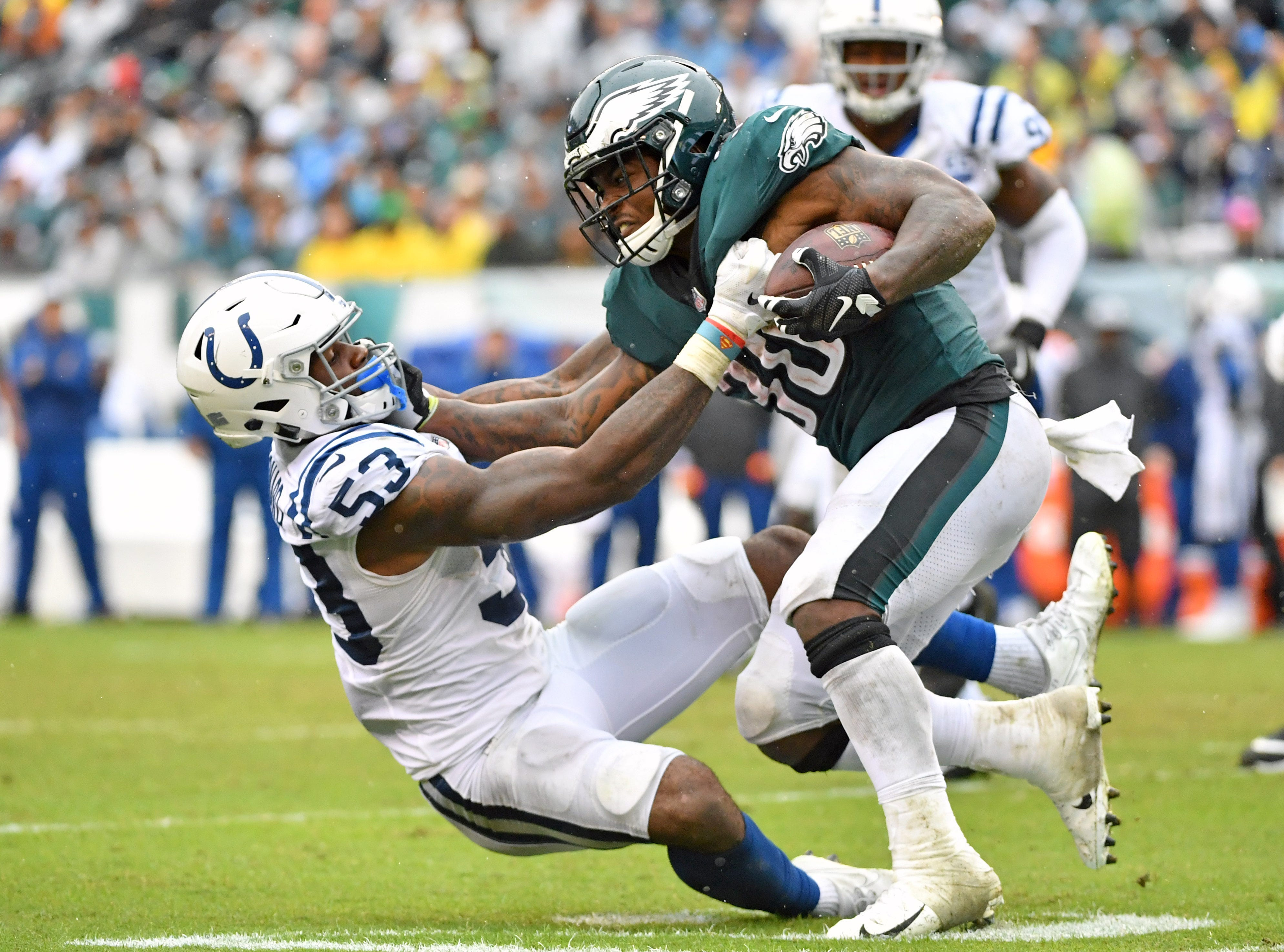 Leonard brings down Eagles running back Corey Clement (30) during the third quarter of their game Sept. 23.