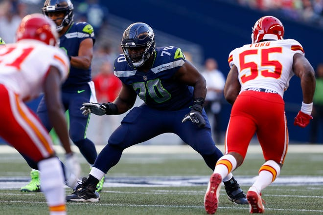 Seattle Seahawks offensive guard Rees Odhiambo (70) blocked against the Kansas City Chiefs during a 2017 game.  Joe Nicholson/USA TODAY Sports
