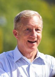 Tom Steyer, NextGen America founder, speaks to members of NextGen Iowa while they register voters on Thursday, Sept. 20, 2018, along Clinton Street on the Pentacrest in Iowa City.