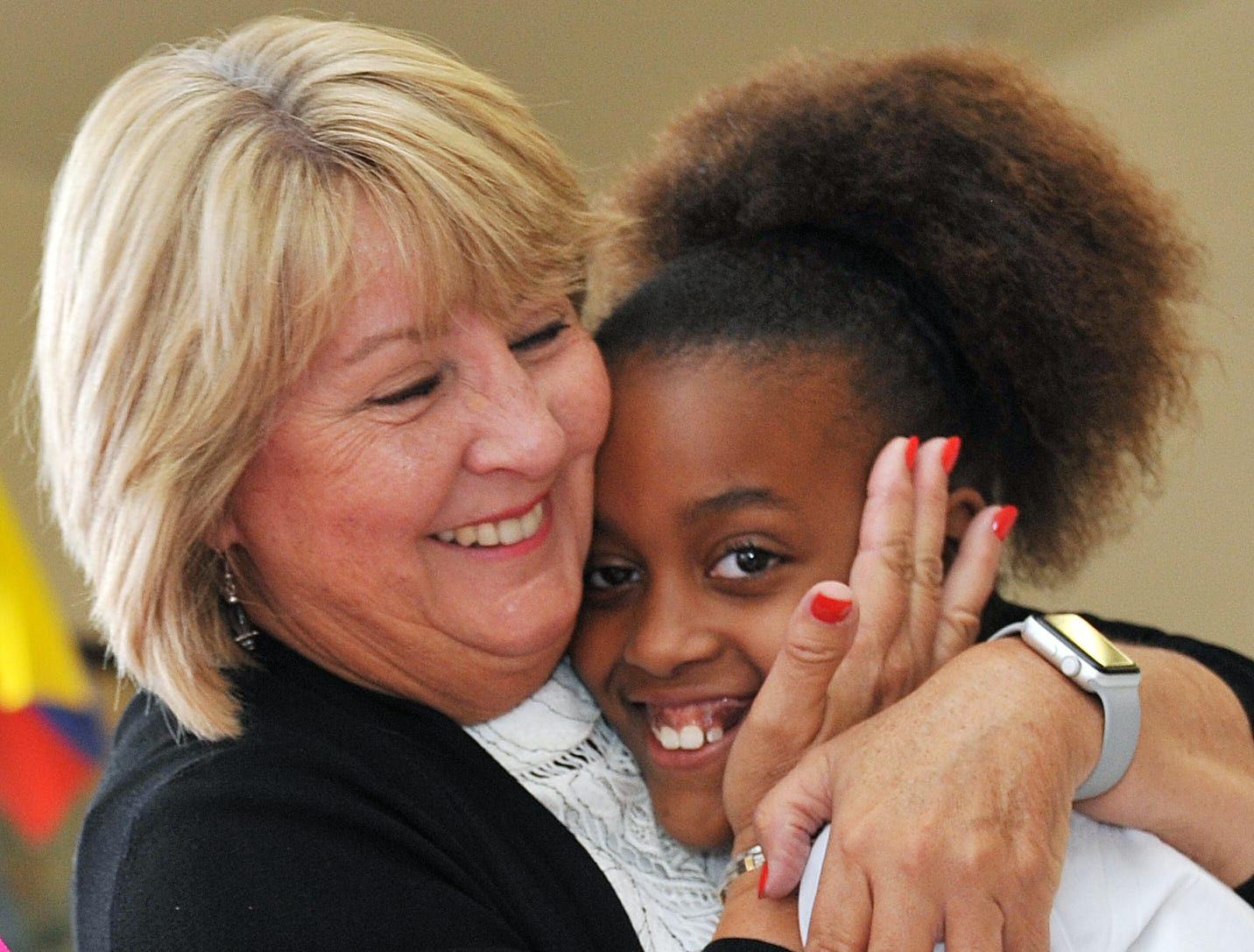 Girls with Purpose Club member Amari Montgomery, gets a hug from Mississippi First Lady Deborah Bryant  during the Girls with Purpose Club Mother-Daughter Tea at Highland Elementary School in Ridgeland.