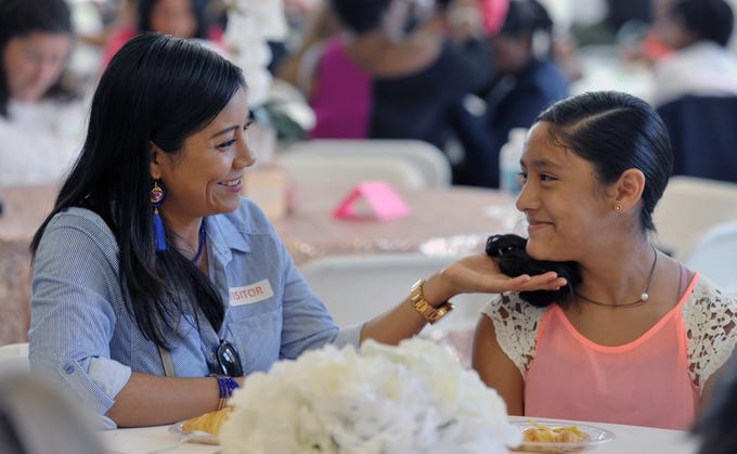 Magali Florentino, left, and her daughter Ingrid Barranco, 11, a 5th-grade student at Highland Elementary in Ridgeland chat before the start of the Girls with Purpose Club Mother-Daughter Tea Friday, Sept. 21.