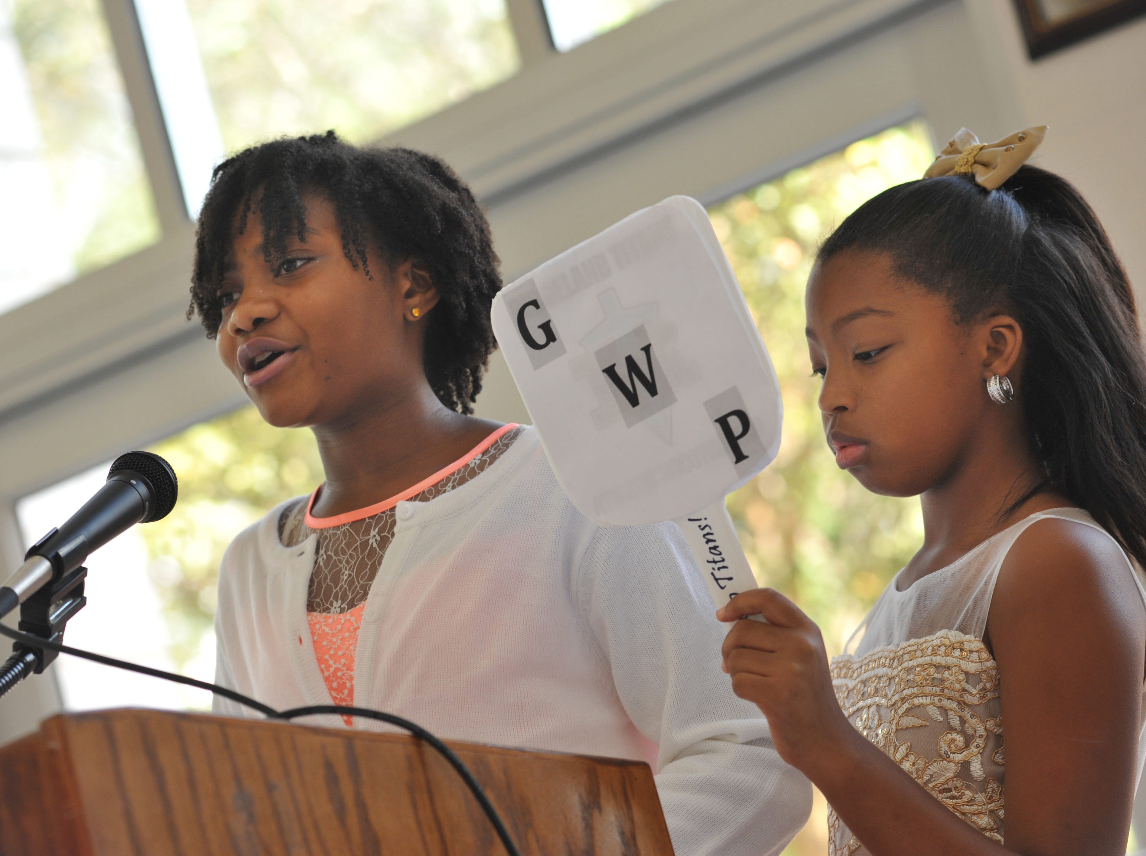 Jaya Thompson, 10, left, addresses the crowd, with fellow Highland Elementary 5th grader Brooklyn Barnes, 10, at her side during the first Girls with Purpose Club Mother-Daughter Tea on Friday, Sept. 21, 2018. With the guidance of a staff club sponsor, Girls with Purpose helps elementary-aged young ladies grow emotionally and socially while developing the skills they will need to succeed beyond the classroom.